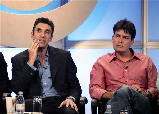 "In this July 20, 2005 file photo, actor Charlie Sheen, right, co-star of ""Two and a Half Men,"" and Chuck Lorre, executive producer of the show, are shown during the CBS portion of the Television Critics Association press tour in Beverly Hills, Calif."
