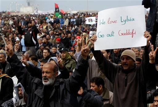 Libyan protesters shout slogans against Libyan Leader Moammar Gadhafi during a demonstration at the court square, in Benghazi, Libya, on Friday Feb. 25, 2011.