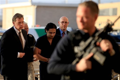 Khalid Ali-M Aldawsari is escorted to his initial court appearance at the Mahon Federal Building in Lubbock, Texas, Friday, Feb. 25, 2011.