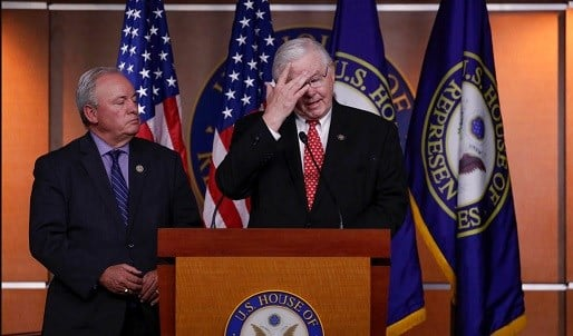 Republican team manager Rep. Joe Barton, R-Texas, right, accompanied by Democrat team manager Rep. Mike Doyle, D-Pa.