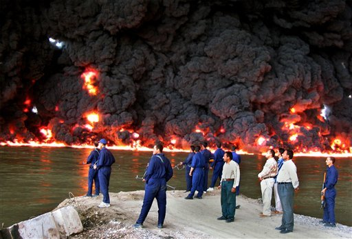 Gunmen attacked Saturday, Feb. 25, 2011, Iraq's largest oil refinery, killing one guard and detonating bombs that sparked a fire and forced the facility to shut down, officials said. (AP Photo/Bassem Daham, File)
