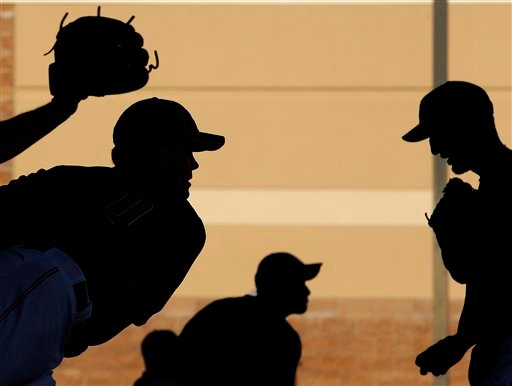 San Diego Padres pitchers work in the bullpen during baseball spring training, Tuesday, Feb. 15, 2011, in Peoria, Ariz. (AP Photo/Charlie Riedel)