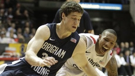 BYU guard Jimmer Fredette and San Diego State's Billy White go to the floor battling for the ball during the first half of an NCAA college basketball game in San Diego, Saturday, Feb. 26, 2011. (AP Photo/Lenny Ignelzi)