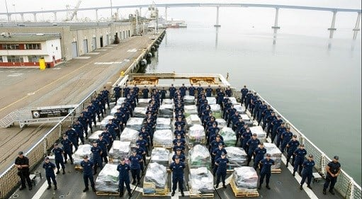 In this photo provided by the U.S. Coast Guard the crew of the Coast Guard Cutter Waesche, prepare to offload approximately 18 tons of cocaine at 10th Ave.