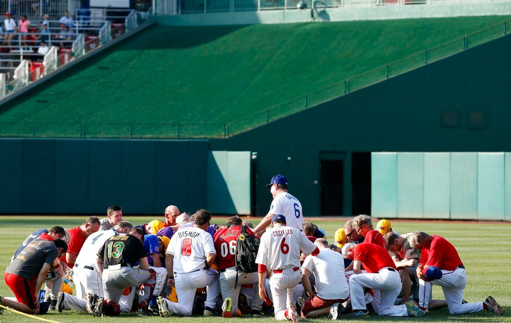 Steve Garvey, former Los Angeles Dodgers player, leads a prayer for the Republican team before the Congressional baseball game, Thursday, June 15, 2017, in Washington. The annual GOP-Democrats baseball game raises money for charity. (AP Photo/Alex Brandon