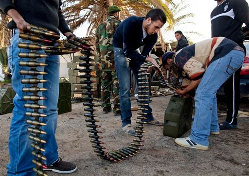 Libyan militia members who are now part of the forces against Libyan leader Moammar Gadhafi organize ammunition at a military base in Benghazi, in eastern Libya, Monday, Feb. 28, 2011.