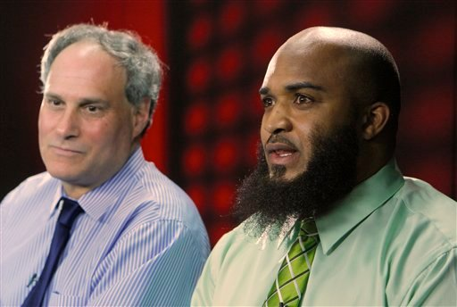 This photo was taken Feb. 14, 2011 of plaintiff Abdullah al-Kidd, right, and his attorney, American Civil Liberties Union Deputy Director of the Immigrants' Rights Project, Lee Gelernt. (AP Photo/Damian Dovarganes)