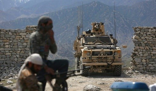 U.S. forces and Afghan security police are seen in Asad Khil near the site of a U.S. bombing in the Achin district of Jalalabad.