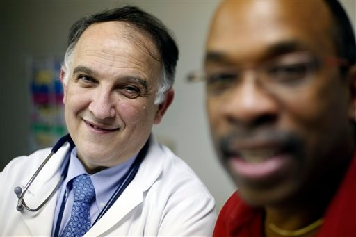 In a Feb. 25, 2011 photo, Dr. Pablo Tebas, left, and Jay Johnson pose for a photograph at the University of Pennsylvania in Philadelphia.