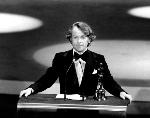 "FILE - In this March 28, 1977, file photo, John G. Avildsen accepts the Oscar for best director for ""Rocky"" at the Academy Awards in Los Angeles."