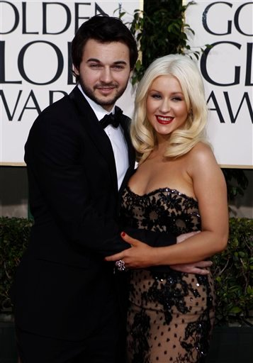 FILE - In this Jan. 16, 2011 file photo, Christina Aguilera, right, arrives with Matthew Rutler for the Golden Globe Awards in Beverly Hills, Calif. Aguilera was arrested early Tuesday, March 1, 2011 near the Sunset Strip on suspicion of being drunk.