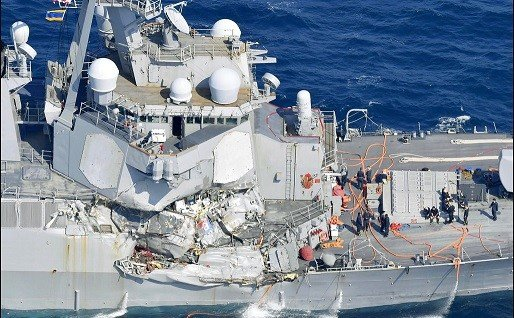 The damage of the right side of the USS Fitzgerald is seen off Shimoda, Shizuoka prefecture, Japan, after the Navy destroyer collided with a merchant ship.
