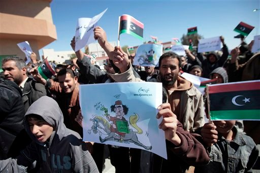 Libyan anti-government protesters, some carrying monarchist-era flags, demonstrate against Libyan leader Muammar Qaddafi, in the southwestern town of Nalut, Libya, Tuesday, March 1, 2011.