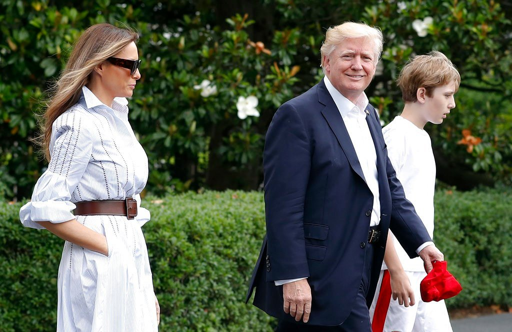 President Donald Trump, first lady Melania Trump, and their son and Barron Trump, walk to Marine One across the South Lawn of the White House in Washington, Saturday. (AP Photo/Carolyn Kaster)