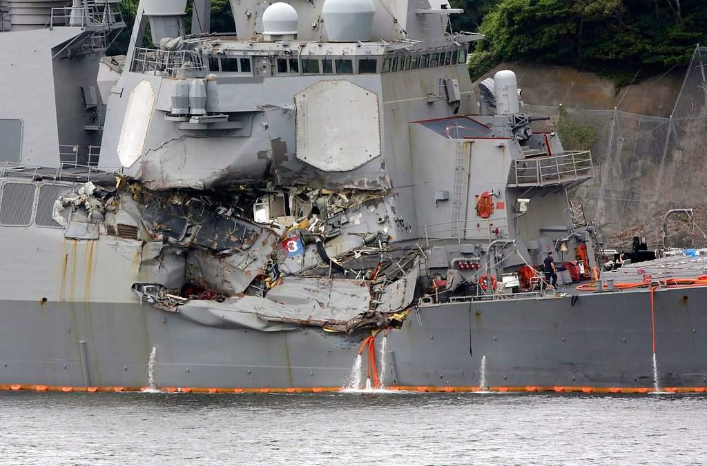 Damaged part of USS Fitzgerald is seen at the U.S. Naval base in Yokosuka, southwest of Tokyo Sunday. (AP Photo/Eugene Hoshiko)