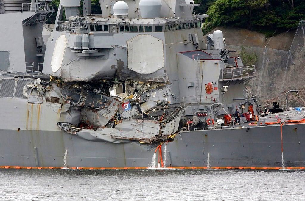 Damaged part of USS Fitzgerald is seen at the U.S. Naval base in Yokosuka, southwest of Tokyo Sunday. (AP Photo/Eugene Hoshiko)