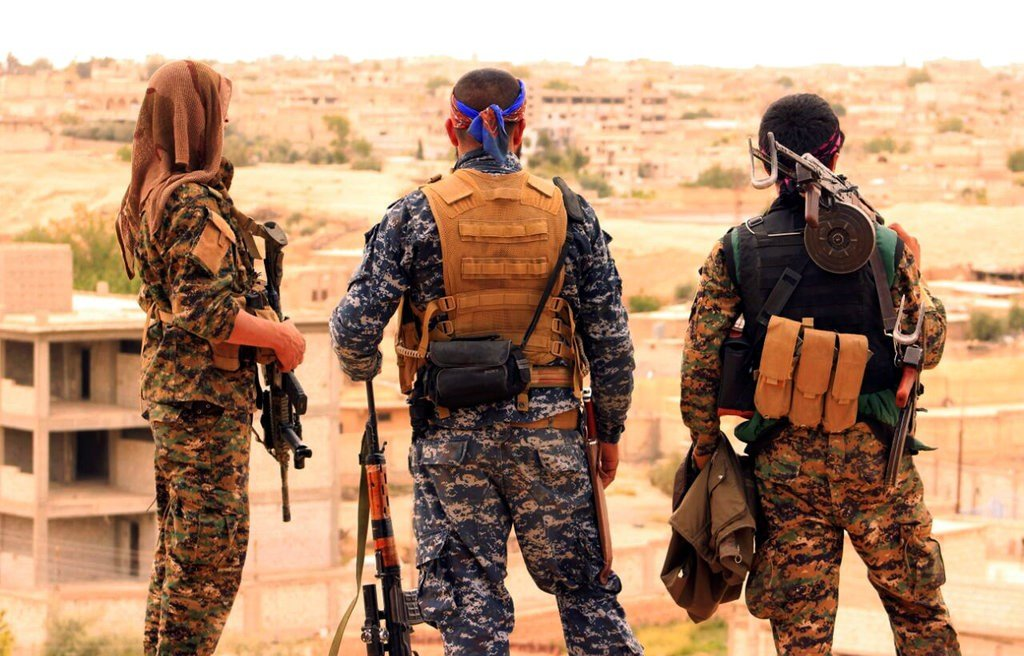 File photo provided by the Syrian Democratic Forces shows fighters from the SDF looking toward the northern town of Tabqa, Syria. (Syrian Democratic Forces via AP, File)