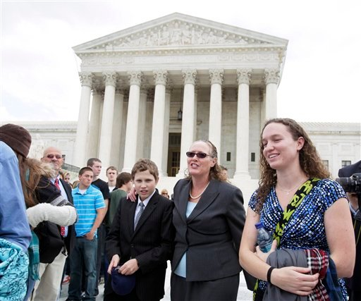 Oct. 6, 2010 file photo: Margie Phelps, second from right, a daughter of Fred Phelps, and the lawyer who argued the case for of the Westboro Baptist Church, of Tokepa Kan., walks from the Supreme Court, in Washington. (AP Photo/Carolyn Kaster, File)