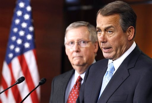 House Speaker John Boehner of Ohio, right, accompanied by Senate Minority Leader Mitch McConnell of Ky. speaks during a news conference on Capitol Hill in Washington, Wednesday, March 2, 2011.