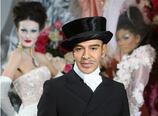 In this Jan. 25, 2010 file photo, fashion designer John Galliano poses at the end of the presentation of the Dior Haute Couture spring/summer 2010 fashion collection in Paris. (AP Photo/Jacques Brinon)