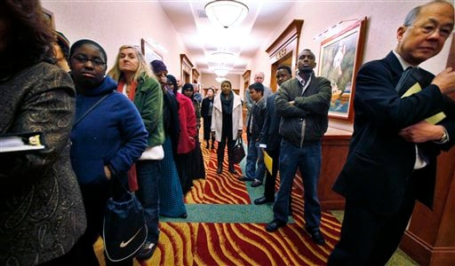 In this March 1, 2011 photo, job seekers line the hall at a job fair in SeaTac, Wash. (AP Photo/Elaine Thompson)