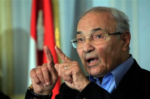 In this Sunday, Feb.13, 2011 file photo Egyptian Prime Minister Ahmed Shafiq talks during a press conference in Cairo, Egypt. (AP Photo/Amr Nabil)