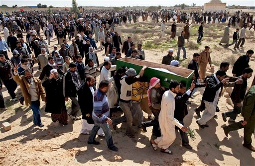 Libyans carry the coffin of a rebel killed in fighting with troops loyal to Libyan leader Moammar Gadhafi on Wednesday, during a mass funeral in Ajdabiya, eastern Libya, Thursday, March 3, 2011. (AP Photo/Kevin Frayer)