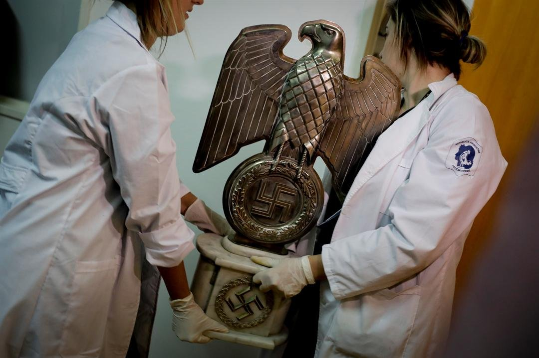 In a hidden room in a house near Argentina's capital, police discovered on June 8th the biggest collection of Nazi artifacts in the country's history.  (AP Photo/Natacha Pisarenko)