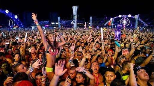 Carnival goers dance to music by Krewella at the Electric Daisy Carnival in Las Vegas.