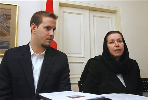FILE - In this Dec. 22, 2007 file photo, Christine Levinson, right, the wife of missing former FBI agent Robert Levinson, and her son Daniel take part in news conference at the Swiss Embassy in Tehran.