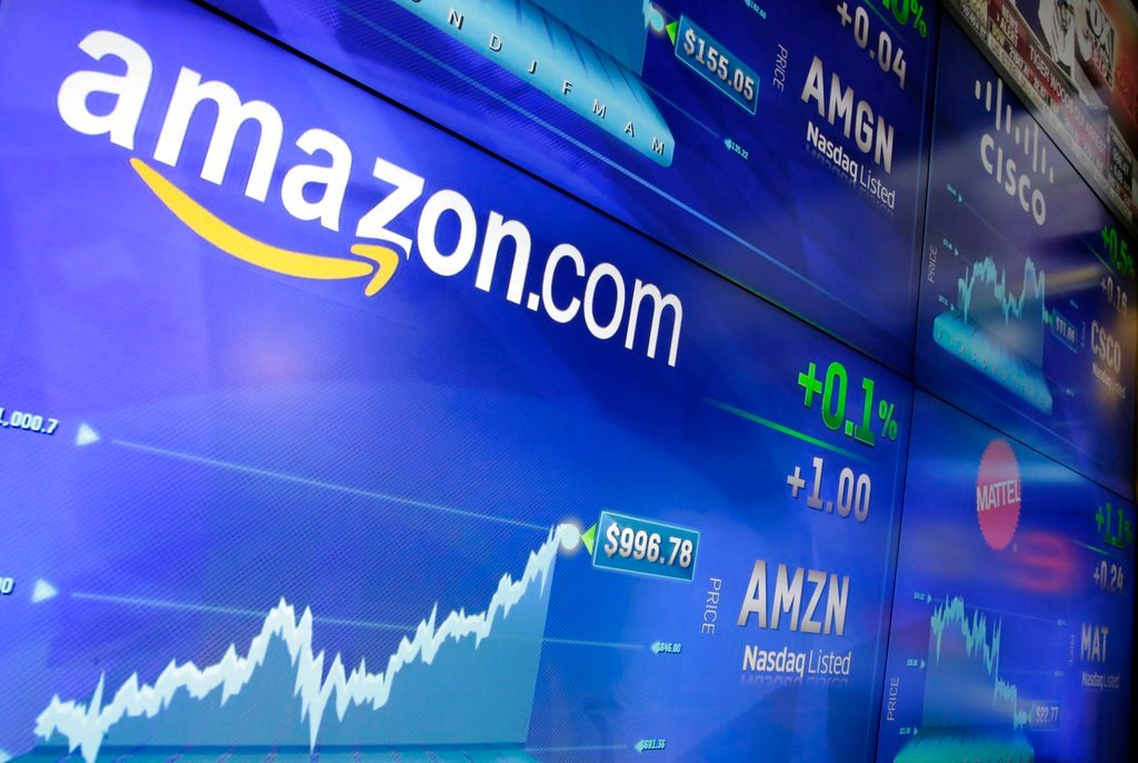 FILE - In this Tuesday, May 30, 2017, file photo, the Amazon logo is displayed at the Nasdaq MarketSite, in New York's Times Square. Amazon announced Tuesday, June 20, 2017, that it's testing a new service for its Prime members that lets customers try on