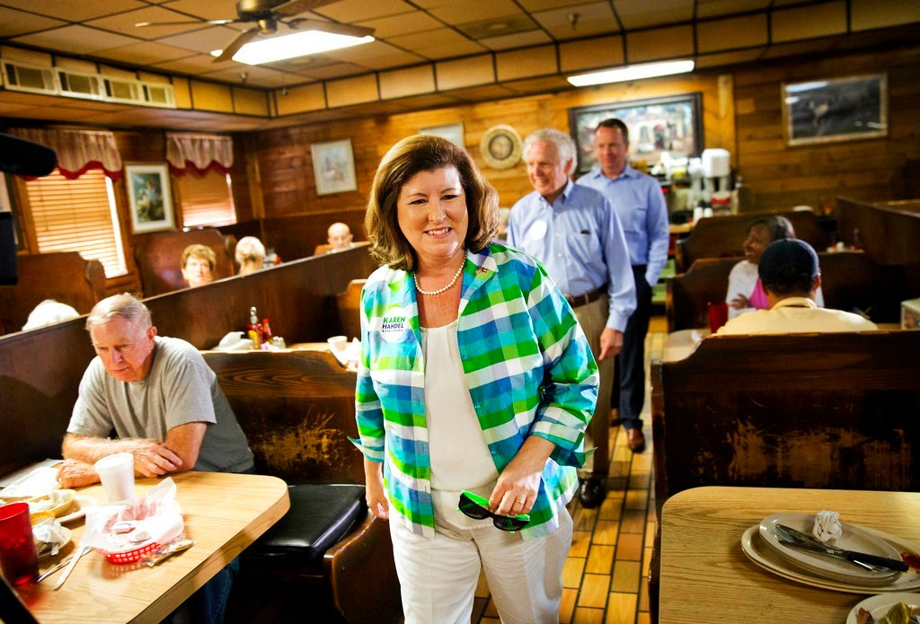 Karen Handel, Republican candidate for Georgia's 6th congressional district greets diners during a campaign stop at Old Hickory House in Tucker, Ga., Monday, June 19, 2017. The race between Handel and Democrat Jon Ossoff is seen as a significant political