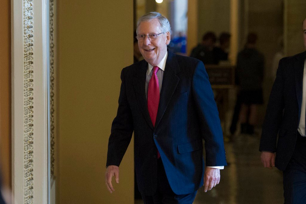 FILE - In this April 6, 2017 file photo, Senate Majority Leader Mitch McConnell of Ky., walks from his office on Capitol Hill in Washington. Democrats plan to slow the Senate's work, force votes and make late-night speeches in an effort to focus attention