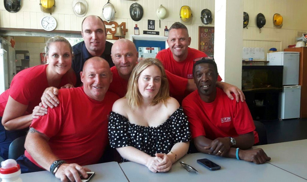 Adele surprises Grenfell Tower firefighters