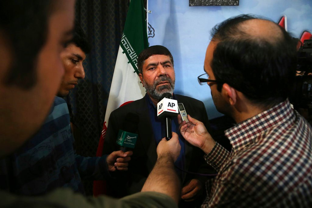The spokesman of Iran's Revolutionary Guard, Gen. Ramazan Sharif speaks with media members at the conclusion of his press conference in Tehran, Iran, Tuesday, June 20, 2017. Sharif, said all six ballistic missiles it launched on Syria hit their targets, a