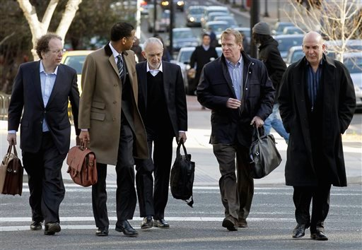 NFL outside labor counsel Bob Batterman, center, NFL commissioner Roger Goodell, second from right, and Peter Ruocco, NFL senior vice president for Labor Relations, right, and others, arrive for football labor negotiations. (AP Photo/Alex Brandon)