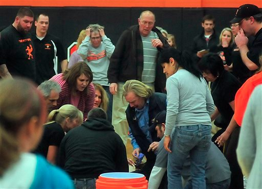 A crowd reacts as paramedics work on Fennville High School basketball player Wes Leonard.