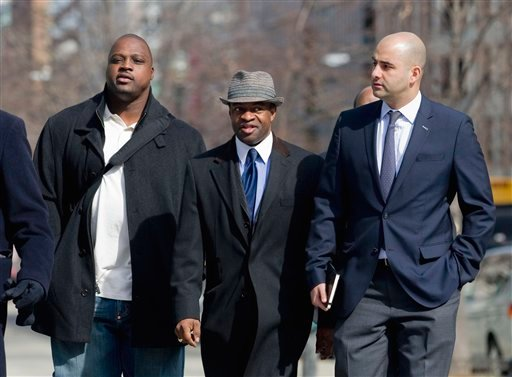 NFLPA Executive Director DeMaurice Smith, center, accompanied by Kansas City Chiefs guard Brian Waters, left, and NFLPA spokesman George Atallah walk to football labor negotiations with the NFL involving a federal mediator, Friday, March 4, 2011.
