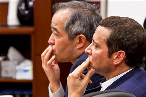 James Ray and Luis Li confer during the morning session on the third day of Ray's criminal trial in Camp Verde, Ariz. on Thursday, March 3, 2011.