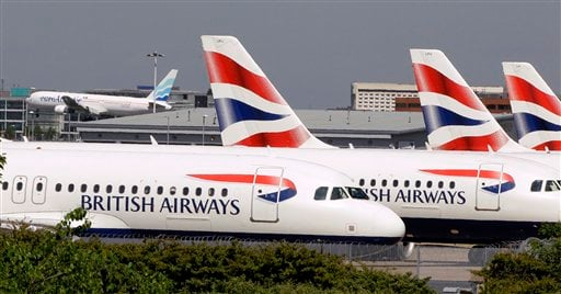 In this May 24, 2010 file photo, British Airways planes are seen parked at Heathrow Airport in London. (AP Photo/Kirsty Wigglesworth, File)