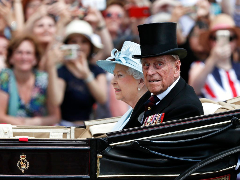 FILE - In this Saturday, June 17, 2017 file photo, Britain's Queen Elizabeth II and Prince Philip return to Buckingham Palace in a carriage, after attending the annual Trooping the Colour Ceremony in London. Buckingham Palace said on Wednesday June 21, 20
