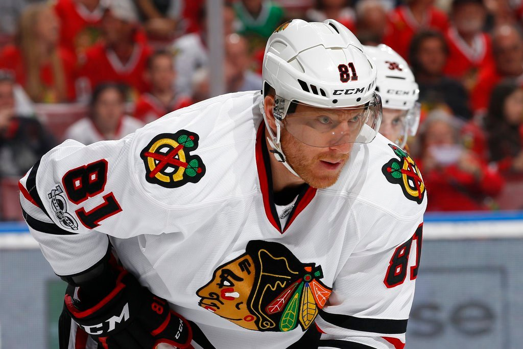 FILE - In this Saturday, March 25, 2017, file photo, Chicago Blackhawks right wing Marian Hossa (81) prepares for a face off against the Florida Panthers during the first period of an NHL hockey game, in Sunrise, Fla. Hossa will miss the entire 2017-18 NH