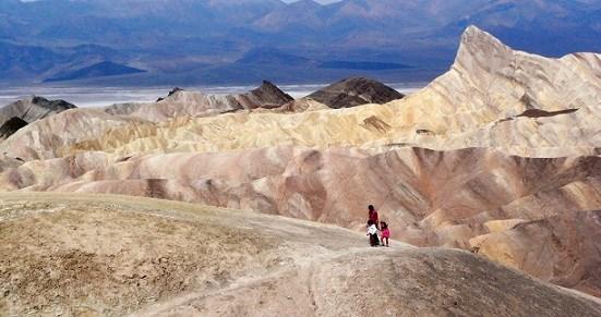 Tourists walk along a ridge at Death Valley National Park, Calif.