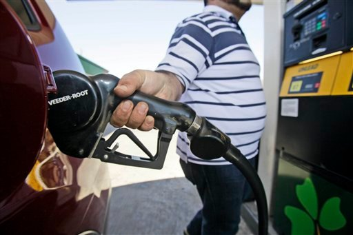In this Feb. 24, 2011 file photo, Juan Zuniga gasses up a SUV in Dallas. Gasoline prices rose more than 2 cents on Thursday to a new national average of $3.228 per gallon. (AP Photo/LM Otero, file)