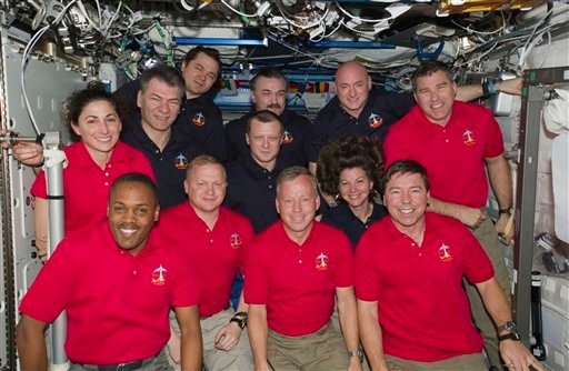 In this March 3, 2011 photo provided by NASA, inside the U.S. lab Destiny, 12 astronauts and cosmonauts take a break from a very busy week. (AP)