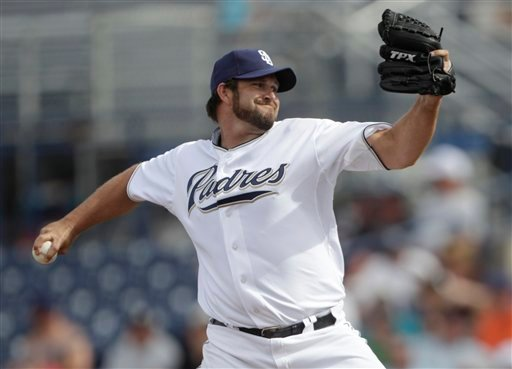 San Diego Padres closer Heath Bell throws during a spring training baseball game against the Oakland Athletics. (AP Photo/Lenny Ignelzi)
