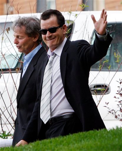 In this June 7, 2010 file photo, Charlie Sheen leaves the Pitkin County Courthouse with his attorney Richard Cummins in Aspen, Colo.