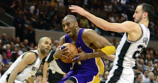 Los Angeles Lakers guard Kobe Bryant drives between the San Antonio Spurs' Tony Parker (9), of France, and Manu Ginobili, of Argentina, during the first half of an NBA basketball game at the AT&T Center in San Antonio, Sunday, March 6, 2011. (AP Photo)