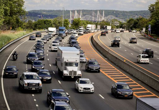Traffic crawls along the westbound lanes of Interstate 287 as motorists get a jump on Memorial Day weekend, Friday, May 26, 2017, in Nyack,N.Y.  (AP Photo/Julie Jacobson)