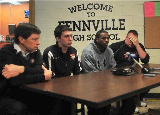 From left, former football coach Tim Schipper, basketball teammates Adam Siegel and DeMarcus McGee and boys' basketball coach ryan klingler react during a news conference Friday, March 4, 2011, in Fennville, Mich, about the death of teammate Wes Leonard.